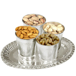 Dry Fruits in Silver Glasses and a Tray