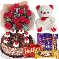 Combo of Cake, Chocolates, Teddy and a Bouquet of Roses