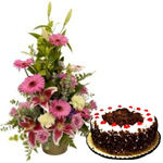 Combo of Black Forest Cake and Basket of Seasonal Mixed Flowers